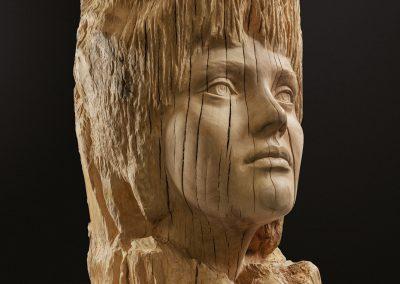 Consolidació - escultura de una cabeza femenina en madera de roble